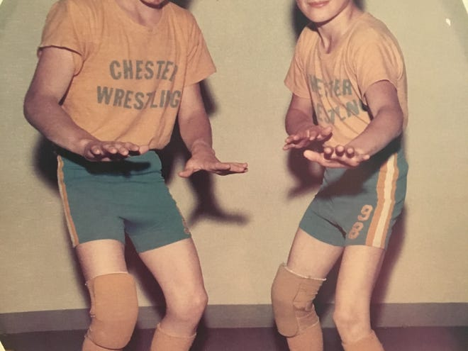 Brothers Colin (left) and Chad Lybeck combined for seven state championships during their magnificent mat careers.