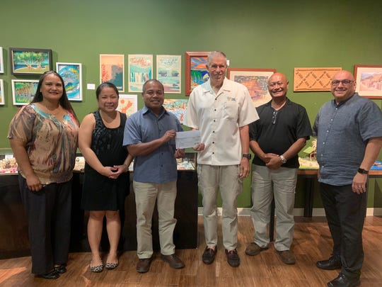 Palau Ministry of Justice made a $20,000 donation to the Friends of The Crime Lab in support of the organization's crime labs efforts on Guam and throughout Micronesia. Pictured from left: Monica Ada Salas, Ana Akigami,  crime lab representatives, Raymond Oilouch vice president and Minister of Justice, Lee Webber, Friends of the Crime Lab BOD, Jose Ise special asst. to the vice president and GPD Capt. Tim Santos.