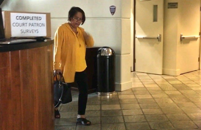Yolanda Digomon, 62, leaves the Guam Judicial Center after her court hearing was postponed. Digomon is charged with fraudulent use of public assistance and other charges.