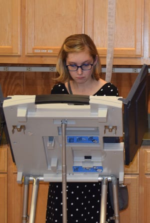 Ariel Credeur casts her ballot Tuesday, Aug. 6, 2019, at Hattiesburg Zoo during Mississippi's primary elections.