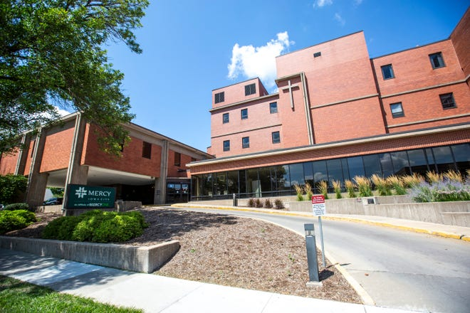 Mercy Hospital is pictured, Tuesday, Aug. 6, 2019, at 500 E Market Street in Iowa City, Iowa.