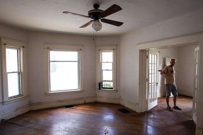 John Engelbrecht, director of Public Space One, stands in the middle of a room that will be renovated into a print shop for the Iowa City Press Co-op, Wednesday, July 31, 2019, at one of the buildings at the future home for Public Space One at 225 N. Gilbert Street in Iowa City, Iowa.