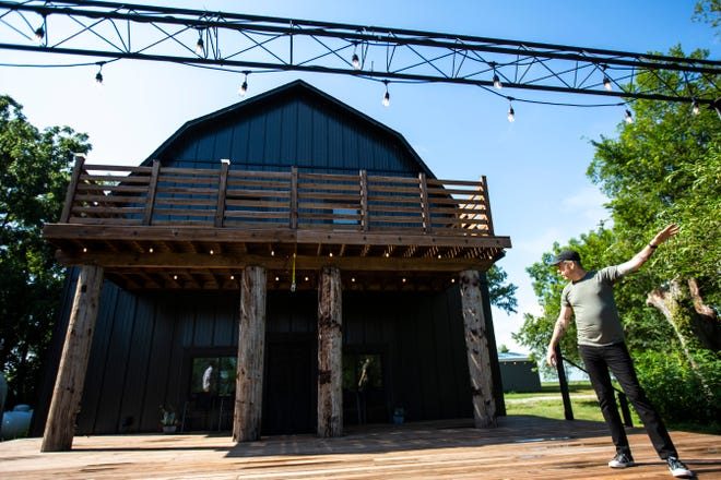 Luke Tweedy, owner and head engineer at Flat Black Studios, gives a tour of the grounds ahead of the third annual Gray Area Music Festival, Tuesday, Aug. 6, 2019, at Flat Black Studios in Lone Tree, Iowa.