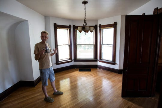 John Engelbrecht, director of Public Space One, stands in the middle of a room that will be renovated into a reading space, Wednesday, July 31, 2019, at one of the buildings at the future home for Public Space One at 229 N. Gilbert Street in Iowa City, Iowa.