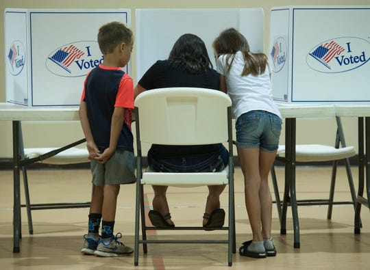 School children receive a real-life civics lesson during 2019 primary elections.