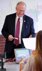 Former Mississippi Supreme Court Chief Justice Bill Waller Jr., a Republican gubernatorial candidate, prepares to vote in the party primary at a Jackson, Miss., precinct, Tuesday, Aug. 6, 2019.