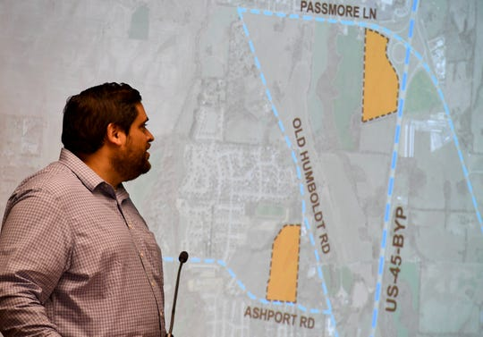 Alex Ruiz of architecture firm Orcutt & Winslow addresses the Jackson-Madison County School Board with the plans for two possible locations for the new K-8 school during the school board meeting, Monday, Aug. 5.