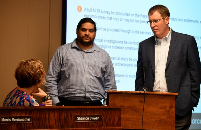 Alex Ruiz and David Stewart of Orcutt-Windslow architecture firm answer questions from board member Shannon Stewart about the new K-8 school during the school board meeting, Monday, Aug. 5.