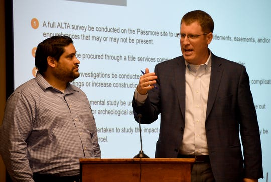 Alex Ruiz and David Stewart of  architecture firm Orcutt & Winslow address the Jackson-Madison County School Board with the plans for two possible locations for the new K-8 school during the school board meeting, Monday, Aug. 5.
