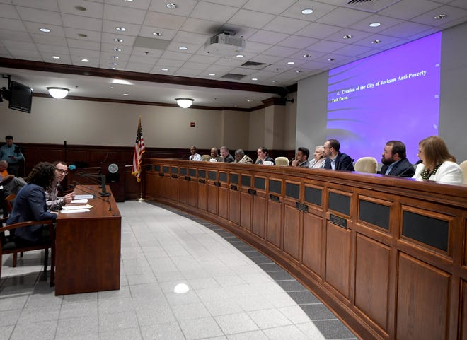 City of Jackson Special Projects Manager Lauren Kirk and administrative assistant Alex Reed address the city council about the Anti-Poverty Task Force during the August 6, meeting.