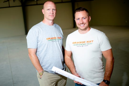Owner Brian Hatmaker and project consultant Rodney Ramin pose for a photo inside the Orange Hat Brewing Company at 10258 Hardin Valley Road in Hardin Valley on Tuesday, August 6, 2019. The brewery opened in February but had to close its taproom to customers weeks later due to the coronavirus.