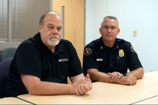 University of Tennessee Emergency Management planning specialist Brad Walker, left, UTPD Chief Troy Lane on Tuesday, August 6, 2019.