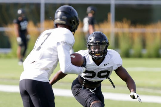 Purdue cornerback Simeon Smiley (29) runs to tackle Purdue cornerback Byron Perkins (17) during practice, Tuesday, Aug. 6, 2019 at Bimel Practice Complex in West Lafayette.