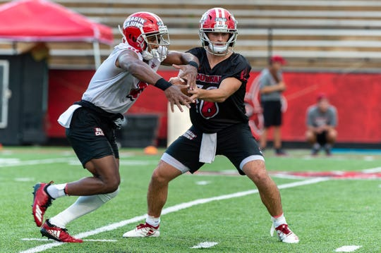 UL running back Raymond Calais Jr. takes a handoff from freshman quarterback Chandler Fields during Ragin' Cajuns Training Camp at Cajun Field Aug. 2. Calais, known for his sprinting ability on the field, contributed 754 yards on the ground and seven touchdowns for the Cajuns in 2018.