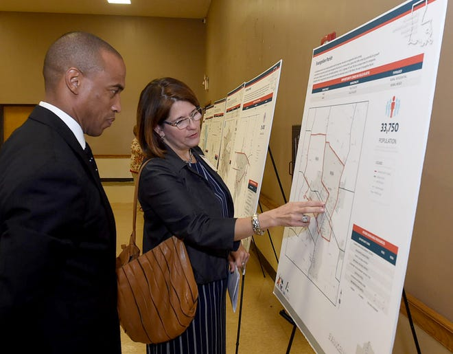 Scott Turner, White House Opportunity Revitalization Council, and Monique Boulet, Acadiana Planning Commission, view maps of opportunity zones located in the Acadiana area.