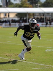 New Orleans Saints defensive back Saquan Hampton (33) runs through drills during training camp at their NFL football training facility in Metairie, La., Monday, July 29, 2019. (AP Photo/Gerald Herbert)