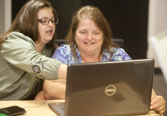 """Programmers Sara Cullop of Highview, top left, and her mother Sharon, members of the development team """"42_Times_Quirky work on a game called """"Spaced Out,"""" during a Louisville Makes Games community collaborative meeting. Sara's father, Bill, is a robotics programmer and Sara wants to follow in his footsteps. Sara's mom, Sharon said that learning game programming was a fun way to begin that process. 04 August 2019"""