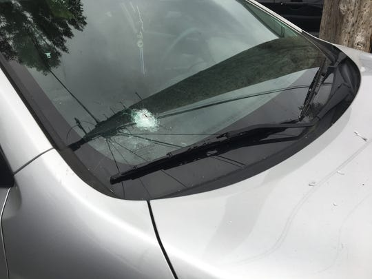 A resident at Stonecrest Townhouses in south Lansing said three vehicles in the parking lot of the townhouses had bullet holes in the windshield after she heard 10 shots fired at about 2 a.m. Aug. 6.