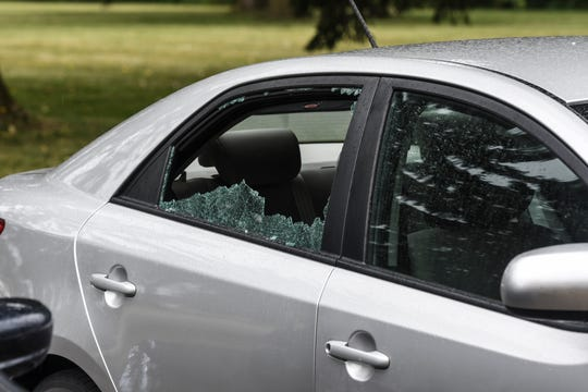 A car with a shot out window near the 2400 block of Risdale St. in Lansing pictured Tuesday, Aug. 6, 2019.