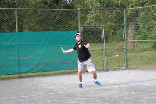 Jacob Byrd hits a forehand during Monday's men's final at Lakewood Racquet Club.