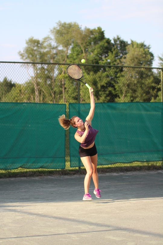 Sylvia Goldsmith reaches for a serve during Monday's women's championship match of Lakewood Racquet Club.