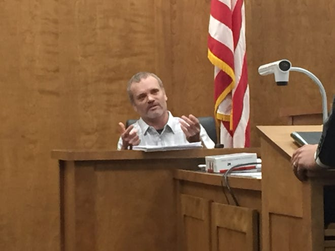 Delbert Matthews takes the witness stand in his trial.