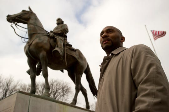 Feb 8, 2013 - Memphis City Council member Lee Harris stands beside a statue of Nathan Bedford Forrest in the recently renamed park where the Confederate general is buried. Harris and fellow council members voted to rename Forrest Park to Heath Science Park in a controversial move that changed the names of several parks with names relating to the Civil War or Confederacy.
