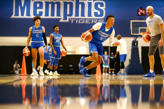 Memphis guard Boogie Ellis drives as assistant coach Cody Toppert yells out instructions during practice Tuesday at the Laurie-Walton Family Basketball Center.
