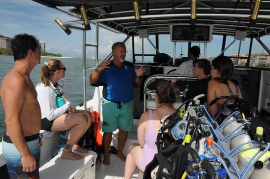 Divermaster John Blake tells his divers what to expect while the boat is heading out. Scuba Marco offers divers the chance to experience scuba diving at reefs and wrecks right off the island's shores.
