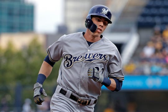 Christian Yelich hits a solo home run in the first inning Monday night.