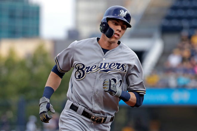 Christian Yelich of the Brewers rounds third after hitting a solo home run during the first inning.
