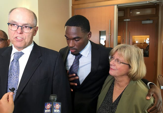 Quintez Cephus' lawyers Stephen Meyer, left, and Kathleen Stilling, right, have petitioned UW-Madison to have Cephus readmitted to the school.