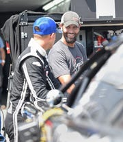 Owner/crew chief Chris Wimmer and his driver, NASCAR Cup rookie Daniel Hemric, chat before practice Tuesday at the Dixieland 250 at Wisconsin International Raceway.