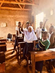 The only girl in a school in Tanzania raises her hand after she was asked who wanted to be a doctor. The Salvatorian Mission Warehouse in Wisconsin (along with Wisconsin nurses and medical professionals) completed its first medical mission in July.