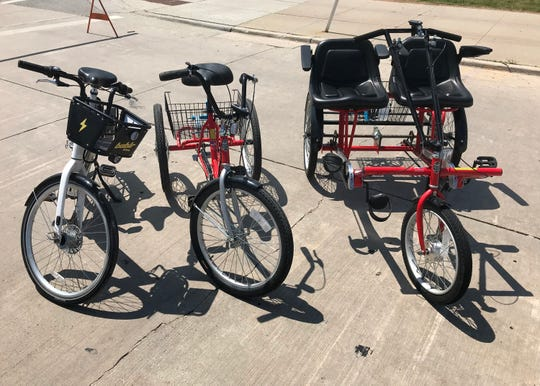 Bublr Bikes' electric bike (left) and two of its new adaptive bikes, which are part of the bike share's new pilot adaptive bike program, are on display Tuesday at Discovery World. The bikes were displayed during a press conference to announce the launch of the pilot program.