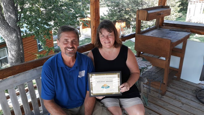 The Mountain Home Area Chamber of Commerce recently held a membership Induction for Holiday Shores Resort on Bull Shoals Lake. Show are owners Lee and June Vanessen.