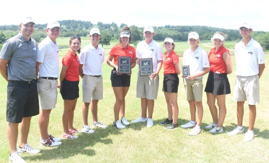Members of the Cabot boys' and girls' golf teams pose with trophies after winning the Ultimate Auto Group Invitational on Tuesday at Big Creek.