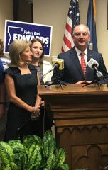 Gov. John Bel Edwards addresses the media Tuesday with First Lady Donna Edwards by his side.