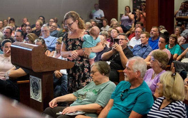 Residents speak at the Muncie City Council meeting on Aug. 5 at the city hall auditorium.