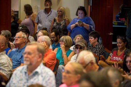 Jim Rybarczyk, bottom left, waits to speak to Muncie City Council on Monday night.