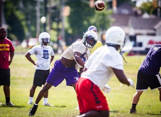 Central's starting quarterback Daire'el Hall practices with teammates at Central Tuesday, Aug. 6, 2019.