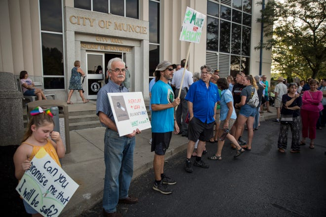 Residents that couldn't make it in the auditorium due to capacity issues wait outside in the lobby and parking lot of city hall during the Muncie City Council meeting on Aug. 5. An at capacity meeting room left hundreds in the lobby and parking lot.