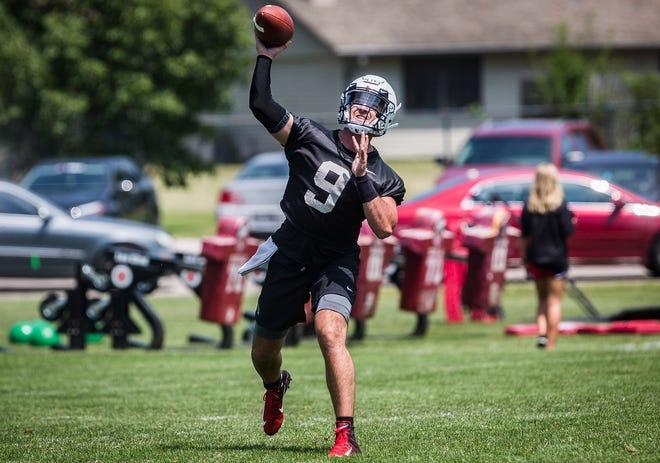 Ball State starting quarterback Drew Plitt passes during practice at Scheumann Stadium.