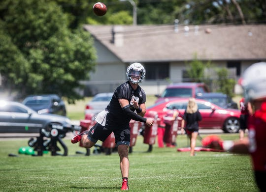 Ball State starting quarterback Drew Plitt passes during practice at Scheumann Stadium.