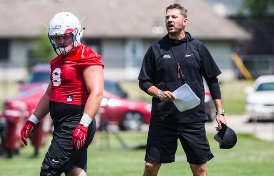 Ball State head coach Mike Neu directs practice at Scheumann Stadium.