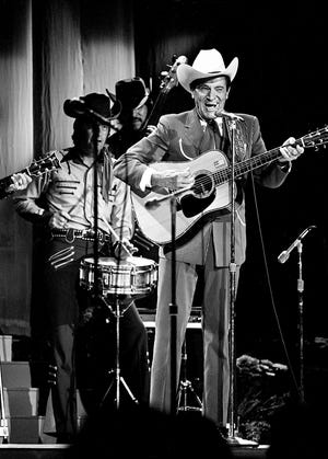 "Ernest Tubb died at age 70 in 1984. Here, Tubb sings ""Walkin' the Floor Over You"" during the sixth annual CMA Awards show Oct. 16, 1972, at the Ryman Auditorium."