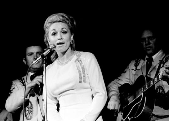 "Dolly Parton was born in Pittman Center, Tenn., in 1946. Here, Parton sings ""Don't Try to Cry"" during the RCA Records show at the D.J. Convention on Oct. 21, 1967, at Municipal Auditorium."
