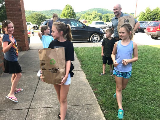The Shipman family arrives at the Liberty Elementary School meet and greet Monday with school supplies in tow. Elizabeth (middle), Rachel, Caleb and dad Scott greet friends on the way into the building.