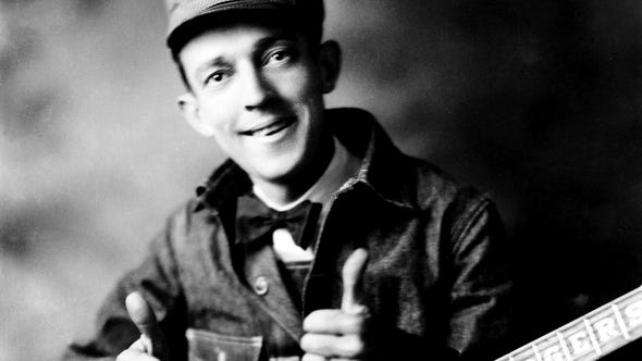 "Jimmie Rodgers released his first ""Blue Yodel (T for Texas)"" in 1928. A dozen sequels would follow over the next five years, until his death in 1933. Rodgers was a Depression-era entertainer who spent time as a railroad worker and was known as the ""Singing Brakeman."""