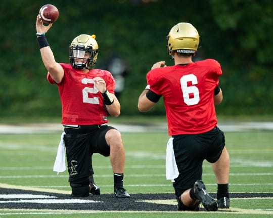 Vanderbilt quarterback Deuce Wallace (2) warms ups with quarterback Riley Neal (6) during practice at Vanderbilt University in Nashville, Tenn., Monday, Aug. 5, 2019.